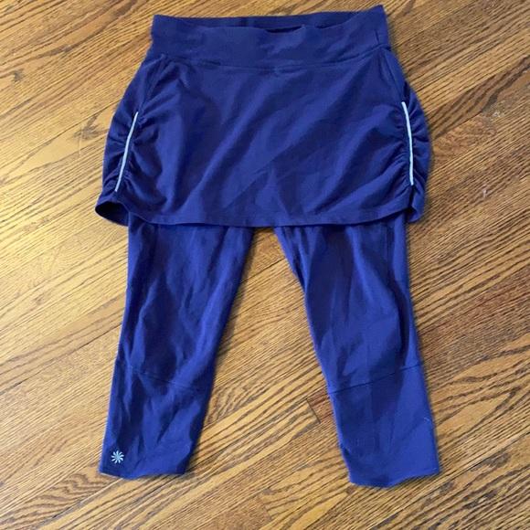 Athleta dark purple skirt/leggings combo.